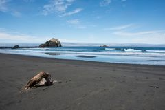 Sea stacks in the Pacific Ocean near Crescent City California on a clear sunny day. With calm waters stock image
