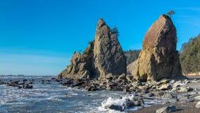 Sea stacks on Rialto Beach. Sea stacks are large rock formations on a coastal shoreline. These sea stack are located on Rialto Beach, outside La Push, Washington stock photos