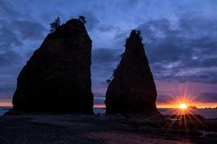 Sea Stacks of Rialto Beach, Washington State. The sun sets at Rialto Beach next to large sea stacks in Washington State stock photos
