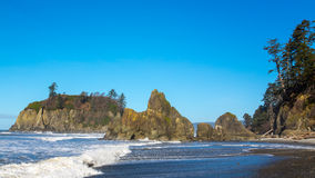 Sea stacks on Ruby Beach. Sea stacks are large rock formations on a coastal shoreline. These sea stacks are located on Ruby Beach on Washington's Pacific coast stock photo