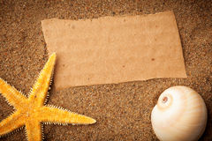Sea star, shell and cardboard Stock Photos