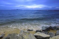Sea and stone beach sunshine Stock Photography