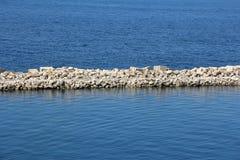 Sea stone and concrete dam Stock Photo