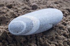 Sea stone on land Stock Photography
