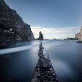 Sea 6 stone stack. Long exposure seascape jetty lots of blue tones Stock Photo