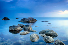 Sea stones. Stones in calm blue sea Stock Photo