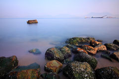 Sea stones along the coast in Hong Kong. It is taken under long exposure Royalty Free Stock Photos