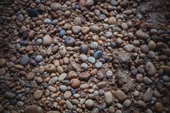 Sea stones background. Abstract texture and background made with small pebbles at the shore.