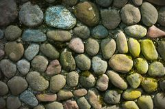 Sea stones background. Rounded stones texture. Colored cobblestone. Building wall from sea stones royalty free stock photos