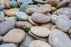 Sea stones. On the beach as background stock photos