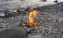 Sea stones bonfire nature fire royalty free stock photo
