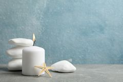 Free Sea Stones, Candle And Seastar On Grey Background, Copy Space Stock Photos - 163953993