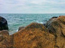 Sea and stones. Sea, stones and cloudy sky Royalty Free Stock Photo