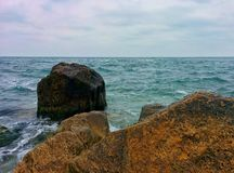 Sea and stones. Sea, stones and cloudy sky Stock Photos