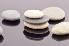 Sea stones are collected in stacks Stock Image