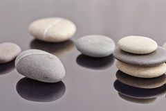 Sea stones are collected in stacks Royalty Free Stock Images