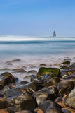 Sea stones in the foreground in the landscape of the sea. Portugal. Royalty Free Stock Photography