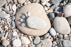 Sea stones laid out in the form of foot prints Royalty Free Stock Photos