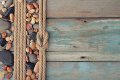 Sea stones with rope Royalty Free Stock Images