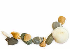 Sea stones and seashells on white background royalty free stock images