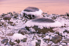 Sea stones in the snow Royalty Free Stock Photos