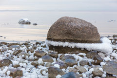 Sea stones in the snow Stock Images