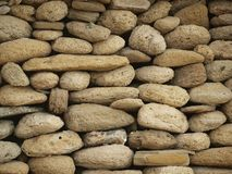 Sea stones standing as a wall Stock Image
