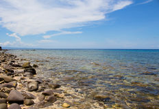 Sea and stones summer vacation travel photo. Tropic island stone beach in sunny day. Royalty Free Stock Images