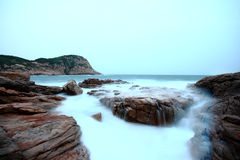 Sea stones at sunset Stock Image