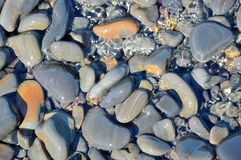 Sea stones, water Stock Photos