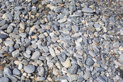 Sea stones or the wet smooth black stone on the beach as backgro Royalty Free Stock Photos