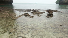 Sea Stony Coast with Very Transparent Water stock footage