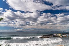 Sea storm clouds beach waves at the Meta Sorrento bay in Italy, end of season, cold weather.  royalty free stock images