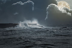 Sea storm in a full moon night Royalty Free Stock Photography