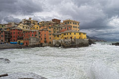 Sea Storm on Genova pictoresque boccadasse village. Sea Storm in a cloudy sky background Royalty Free Stock Photos