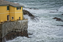 Sea Storm on Genova pictoresque boccadasse village. Sea Storm in a cloudy sky background Stock Photos