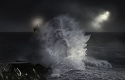 Sea storm at night. Sea storm in a dark cloudy full moon night Stock Photography