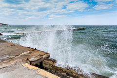 Sea storm and splashes of surf Stock Photos