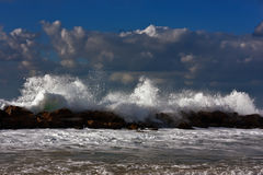Sea storm on the sunset beach royalty free stock photography