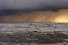 Sea storm at sunset Stock Photography