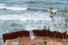 The sea and the storm, the waves break about fencing royalty free stock photos