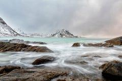 Sea stream through rocks royalty free stock photography
