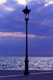 Sea and streetlight late night Stock Photos