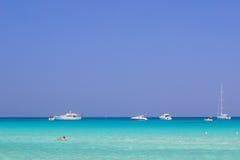 Sea summer beach boats sky Stock Photos