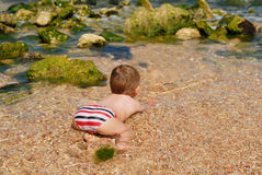 Sea, summer, boy, funny, ocean,   water, sand, enjoy, relax, vacation Royalty Free Stock Photo