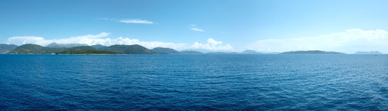 Sea summer coastline view from ferry (Greece). Panorama. Stock Photography