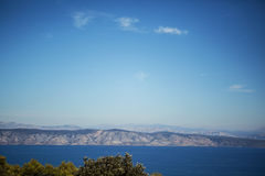 Sea summer panorama, blue mountains Royalty Free Stock Images