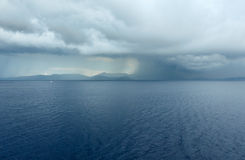 Sea summer view with stormy sky (Greece) Stock Photos