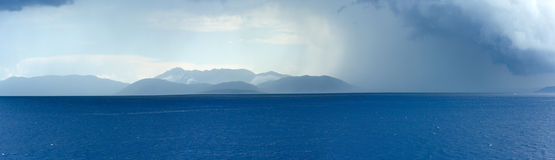 Sea summer view with stormy sky and rain (Greece) Stock Images