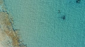 The sea the sun and the beautiful ripples. Shallow waters close to a beach creating a light blue green color. The wind is creating small ripples on the water Royalty Free Stock Photography